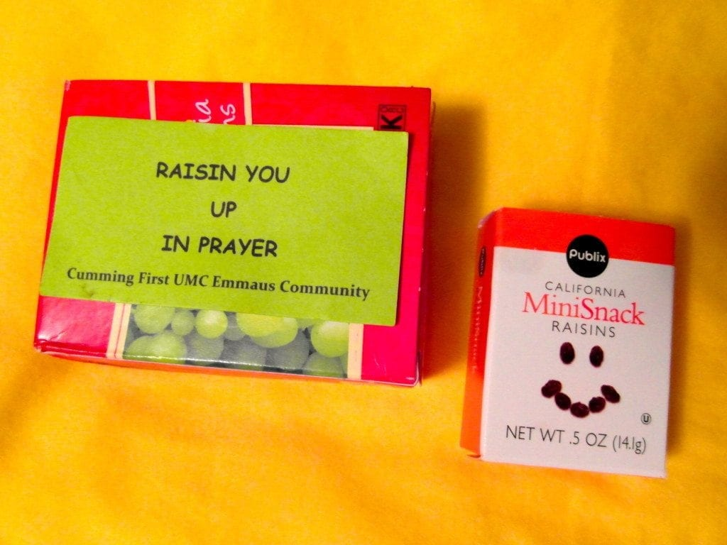 "Small box of raisins with card saying ""Raisin You Up in Prayer"""