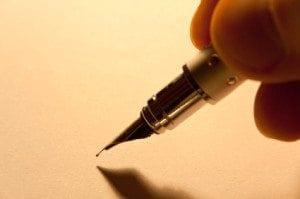 Pen in hand writing palanca - agape letter