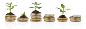 Coins with plants growing from the top of them.